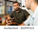 casual meeting in a coffee shop | Shutterstock . vector #302995121