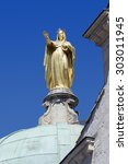 Small photo of golden statue of Saint Anne on the Dome of the Cathedral of Sainte Anne against the blue sky in Apt, Provence, France