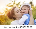 happy mother and her baby...   Shutterstock . vector #303025229