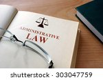 Small photo of Code of administrative law on a wooden table.