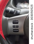 Small photo of the cruise control button on a steering wheel.