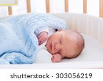 newborn baby in hospital room.... | Shutterstock . vector #303056219