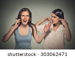 Small photo of Portrait two women loud, obnoxious rude woman talking loudly on cell phone, girl next to her pissed off closes ears having headache Isolated gray background. Negative emotion facial expression feeling