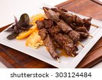 delicious pork kebab with... | Shutterstock . vector #303124484