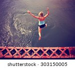 a girl jumping of an old train ... | Shutterstock . vector #303150005