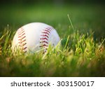 a baseball in a grass during... | Shutterstock . vector #303150017