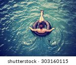 a man floating down a river in... | Shutterstock . vector #303160115