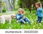 Stock photo beautiful woman with little girl and dog playing outdoors 30320320