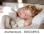 sweet little child sleeping in... | Shutterstock . vector #303218921