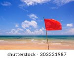 Red Warning Flag On Beach ...