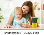 mother helping her kid son to... | Shutterstock . vector #303231455