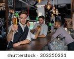 beer evening in a pub. portrait ... | Shutterstock . vector #303250331