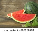 Watermelon And Sliced Ripe On...
