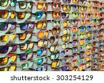 Many Different Sunglasses At...