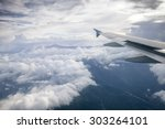 wing of an airplane flying... | Shutterstock . vector #303264101