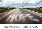 hope written on rural road | Shutterstock . vector #303317735
