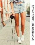 youtdoor crop foot of tanned... | Shutterstock . vector #303369131