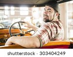 man looking at auto through old ...   Shutterstock . vector #303404249