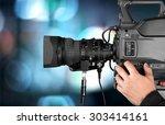 filming  camera operator  home... | Shutterstock . vector #303414161