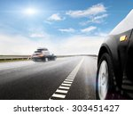 blurred car on icy road with sky | Shutterstock . vector #303451427