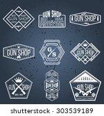 gun shop logotypes and badges    Shutterstock .eps vector #303539189
