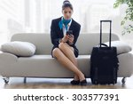 portrait of beautiful hostess... | Shutterstock . vector #303577391