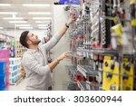 customer in a tool store | Shutterstock . vector #303600944