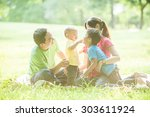 boys with family in the summer... | Shutterstock . vector #303611924