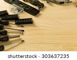 set of working tools on wooden... | Shutterstock . vector #303637235