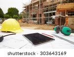 close up of plans and digital...   Shutterstock . vector #303643169