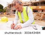 construction worker looking at... | Shutterstock . vector #303643484