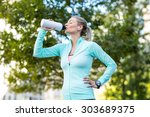 a beautiful woman drinking... | Shutterstock . vector #303689375