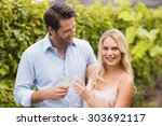 young happy couple smiling at... | Shutterstock . vector #303692117