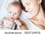 funny baby girl make selfie on... | Shutterstock . vector #303714935