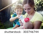 a young mother feeding milk the ... | Shutterstock . vector #303746744