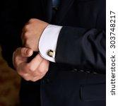 hands of wedding groom getting...   Shutterstock . vector #303748217