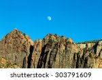 Moonrise Over Rocky Bluffs In...