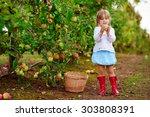 pretty little girl picking... | Shutterstock . vector #303808391