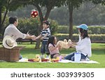 family having fun at a picnic | Shutterstock . vector #303939305