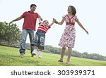 son having fun with his parents | Shutterstock . vector #303939371