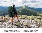 hiker with backpack relaxing on ... | Shutterstock . vector #303950309