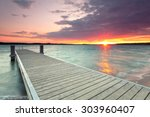wooden jetty at lake ... | Shutterstock . vector #303960407