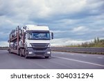 car carrier on the highway at... | Shutterstock . vector #304031294