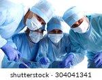 team surgeon at work in... | Shutterstock . vector #304041341