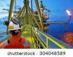 workers and offshore rig... | Shutterstock . vector #304048589