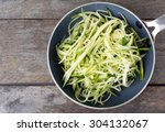 grated zucchini and squash in... | Shutterstock . vector #304132067