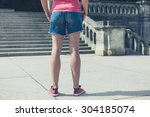 a young woman is standing near... | Shutterstock . vector #304185074