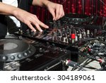 dj at dance party mixes track... | Shutterstock . vector #304189061