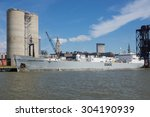 CLEVELAND, OHIO   AUGUST 7, 2015: The 50 year old ship Stephen B. Roman delivers it's load of hydraulic cement to the ESSROC plant on the Cuyahoga River in Cleveland, Ohio. - stock photo