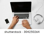 man hand on laptop on table top ... | Shutterstock . vector #304250264